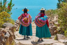 Two,Indigenous,Quechua,Women,In,Traditional,Clothes,Walking,Down,The