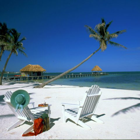 VICTORIA HOUSE  Ambergris Caye,BelizeBeach, chairs & view to jetty