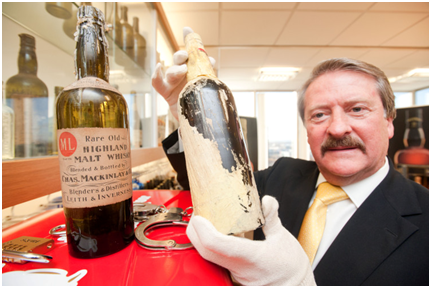 Richard Paterson with one of Shackletons original bottles